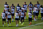 France players run on the pitch during a training session ahead of their clash with Germany. Photo / AP