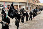 ISIL fighters marching in Syria. Photo / AP