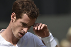 Andy Murray wipes his brow after playing a point against Grigor Dimitrov. Photo / AP