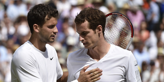 Grigor Dimitrov of Bulgaria, left, is congratulated by defending champion Andy Murray of Britain after winning their men's singles quarter-final match at Wimbledon. Photo / AP