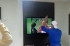 A video of Brazilian football fan Rafael Gambarim has gone viral after he was caught becoming so overcome with emotion while watching the host nation's penalty shootout against Chile that he smashed his TV set.