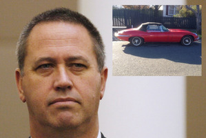 Michael Swann and the E-Type jaguar sports car he is thought to be linked to.