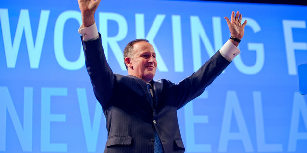 Prime Minister John Key waves to supporters after his pre-election speech to the National Party conference. Photo / Mark Mitchell