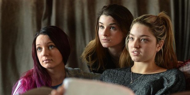 Recovering from a brutal bashing at the hands of a large group of teenage girls in Dunedin on Saturday night are (from left) Makayla Spiers, Annalise Cooper and Tae Flavell. Photo / Stephen Jaquiery.