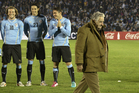 Uruguay's President Jose Mujica, right, leaves the field before a Uruguay game earlier in the year. Photo / AP