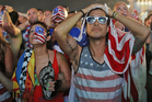 USA fans react during the side's second round defeat to Brazil. Photo / AP