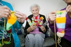 SPINNING YARNS: Betty Cottle and her friends have knitted hundreds of colourful dolls for children staying in Tauranga Hospital.PHOTO/ANDREW WARNER