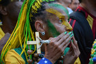 A Brazilian football fan watches a game anxiously. Photo / Creative Commons image by Flickr user Ben Tavener
