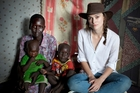 British actress Keira Knightley meets local widow Rebecca Karkwasni, who was reunited with her children at the camp. Photo / Panos