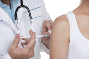 Person receiving a vaccine.