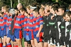 Central players, left, and their Napier Pirate Rugby and Sports opponents during their minute's silence in memory of Central's Robbie Barr who died in a building accident last week. Photo/Warren Buckland