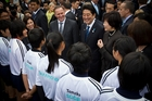 Sports students meet the leaders during Shinzo Abe's brief visit. Photo / Greg Bowker