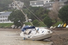 A yacht beached at Opua due to this week's strong winds. Photo / Peter de Graaf
