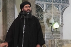 This image made from video posted on a militant website purports to show the self-proclaimed leader of the Islamic State group (Isis), Abu Bakr al-Baghdadi, delivering a sermon at a mosque in Iraq. Photo / AP