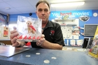 Kevin Knox, owner of Video Ezy Greenmeadows, Napier, with a charity donation box for the Royal New Zealand Foundation for the Blind, which a Video Ezy member allegedly tried to steal at the weekend. He was thwarted by the Velcro dots attaching the box to the counter. Photo/Duncan Brown