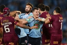 State of Origin may be confrontational but let's not confuse it with war. Photo / Getty Images