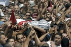 Relatives and friends of Mohammed Abu Khder, 16, carry his body to the mosque during his funerals in Shuafat, in israeli annexed East Jerusalem. Photo / AP