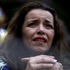 A Brazilian soccer fan cries as she watches her team get beat during a live telecast of the semi-finals World Cup soccer match between Brazil and Germany, in Belo Horizonte, Brazil. Photo / AP