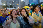 Brazil soccer fans cry as they watch their team play against Germany on a live telecast inside the FIFA Fan Fest area on Copacabana beach in Rio de Janeiro, Brazil. Photo / AP
