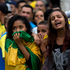 Brazil soccer fans watch their team lose to Germany at a World Cup semifinal game on TV in Sao Paulo, Brazil. Photo / AP
