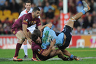 Aidan Guerra tackles Jarryd Hayne. Photo / Getty Images