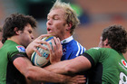 The Stormers' Schalk Burger, centre, is tackled during the Super Rugby match between the Stormers and the Bulls at Newlands in Cape Town. Photo / Getty Images