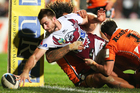 Manly's Kieran Foran scores a try during the NRL match between the Sea Eagles and the Wests Tigers at Brookvale Oval in Sydney. Photo / Getty Images