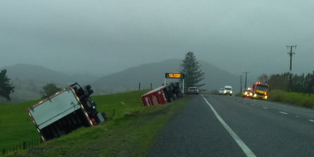 Loading Two trucks blown off the road near Kaiwaka. Photo / Bernie Stewart