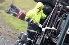 Blustery winds blew two trucks off State Highway 1, just south of Kaiwaka, today. A tow truck was used to pull a truck and trailer unit back on the road.