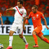 Marco Urena of Costa Rica and Wesley Sneijder of the Netherlands in action during the World Cup quarter-final match between the Netherlands and Costa Rica. Photo / Getty Images