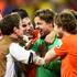 Tim Krul, centre, is mobbed by his teammates at the end of the game. Photo / Getty Images