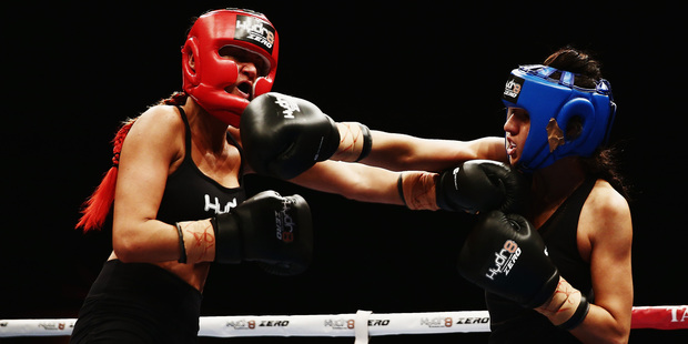 Girls from The GC, Jade Louise, left, and DJ Tuini, battle it out at the boxing night at the Vodafone Events Centre last night. Photo / Getty Images
