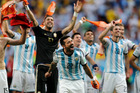 Argentina's Ezequiel Lavezzi and teammates celebrate at the end of the World Cup quarterfinal soccer match between Argentina and Belgium at the Estadio Nacional in Brasil. Photo / AP.