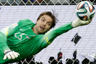 Netherlands' goalkeeper Tim Krul saves the last penalty kick during the World Cup quarterfinal soccer match between the Netherlands and Costa Rica. Photo / AP