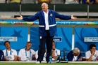 Brazil's coach Luiz Felipe Scolari spreads his arms as he watches the World Cup semifinal soccer match between Brazil and Germany at the Mineirao Stadium. Photo / AP