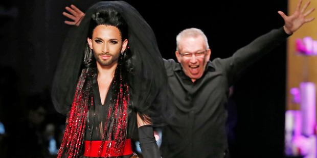 French designer Jean-Paul Gaultier, background, appears behind Austrian singer and Eurovision Song Contest winner Conchita Wurst. Photo / AP