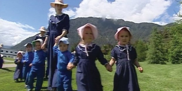 Children dressed in Cooperite clothing walk at Gloriavale. Photo / TVNZ file