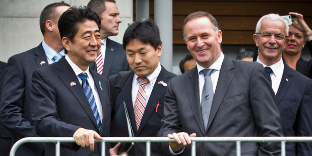 Shinzo Abe (left) and John Key have much work to do  if a basic deal is to emerge by the end of this year.  Picture / Greg Bowker