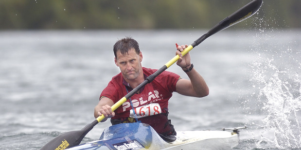 Individual entry Scott Donaldson from Rotorua comes from the kayak leg of the Wild Moa on Lake Tarawera on Saturday 13 January 2007 Daily Post Photograph by Ben Fraser DPM 25Apr14 - TASMAN CRO