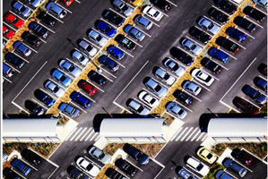Aerial view of the Albany Park 'n Ride car park in Auckland. As more people take to public transport the parking problem is only shifted to other areas. Photo / Richard Robinson