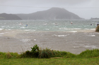 Waves smash at Houhora Harbour as the storm presses down in the Far North. Photo / Northern Advocate / Petrina Hodgson
