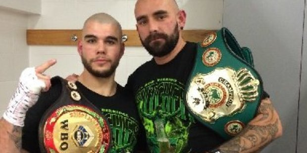 Robert Berridge with his cousin Paul and the WBO Asia Pacific and PABA light heavyweight title belts after the first round knockout of Brazilian Rogerio Damasco on Saturday night. Photo/Supplied