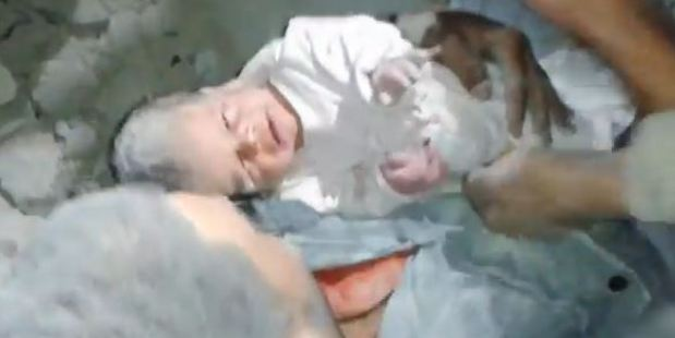 Video footage shows a baby being rescued from the rubble in Syria.