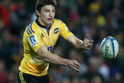 Beauden Barrett has re-committed to the Hurricanes for the next two years. Photo / Getty