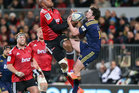 Nemani Nadolo and Richard Buckman compete for a high ball during the Crusaders' win over the Highlanders. Photo / Getty