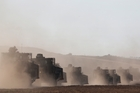 Israel is massing tanks along the border with Gaza as hardliners call for ground campaign to back air attacks. Photo / AP