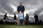 Everard Reid with 4-year-old son Darrell and four of the lads he is mentoring. From left are Kainoa Smith, Te Wheturere Ferris, Kalhain Collier and Kaya Wainohu. Photo/Paul Taylor