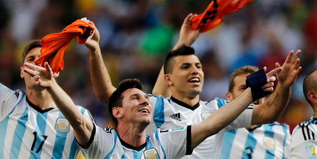 Argentina's Lionel Messi and teammates celebrate at the end of the World Cup quarter-final between Argentina and Belgium. Photo / AP