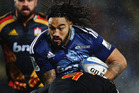 Ma'a Nonu takes it up the guts in his final run with the Blues. Photo / Getty