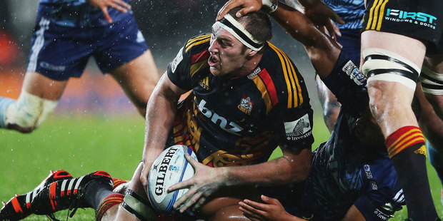 Chiefs lock Brodie Retallick looks to offload a ball during his side's win at Eden Park. Photo / Getty